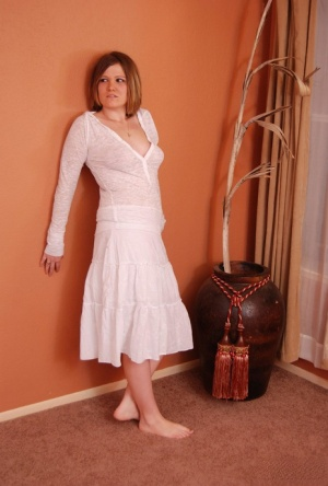 Amateur woman Summer looses her firm breasts from a white dress