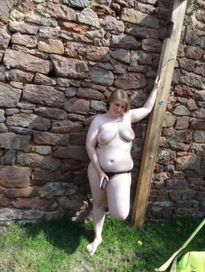 Overweight amateur Fr Lizzy masturbates in a yard while sporting nipple clamps