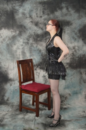Redhead Lady Nadja is gagged  restrained before being covered with a raincoat