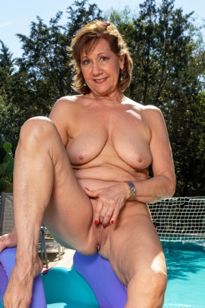 Older lady removes a dress and bikini before masturbating next to a pool