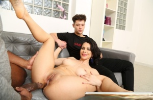 Dark haired wife gets slammed by a big black cock in front of her man