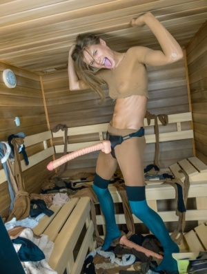 Beautiful girl Sarah Kay sports a long strapon cock while covered in pantyhose