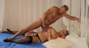 Blonde chick Krystal Swift takes a cumshot on her huge breasts after fucking 21794124