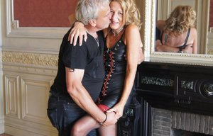 Mature amateur engages in lesbian play before kissing her husband