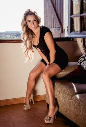 British glam model Harriette Taylor strips to high heels in front of a window