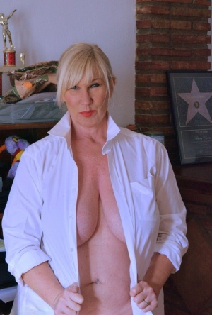 Overweight mature blonde Melody uncups her boobs before showing her huge ass