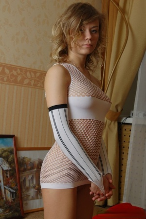 Cute 18 year old blonde Veta gets naked in leg warmers and arm socks