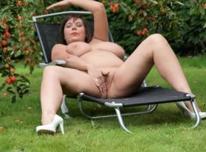 Amateur plumper Roxy uncovers her huge tits before touching her twat in a yard