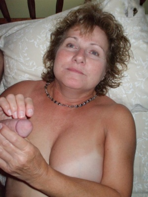 Busty older lady Busty Bliss engages in oral sex with her man friend