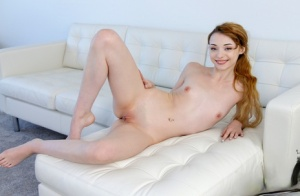Skinny redhead Cecelia Taylor uncovers her flat chest before parting her pussy