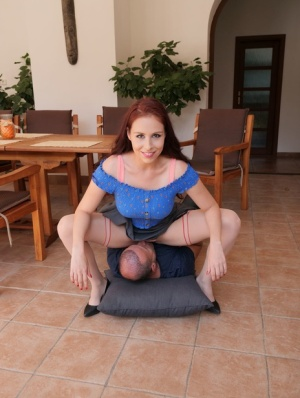 Natural redhead Antonia Sainz uncovers her big tits while face sitting a man