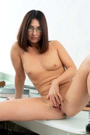 Middle-aged secretary Eva Black makes her nude debut at work in glasses