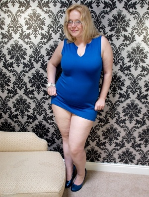 Amateur BBW Sindy Bust strips to her bra  panties before donning long gloves