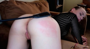 Female slave Anna Claire wears a mesh top during POV sex games