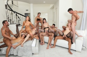 Hot girls and men partake in bisexual group sex in the living room