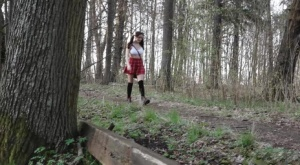 Solo girl Alexa hikes up her skirt before taking a pee during a walk in woods