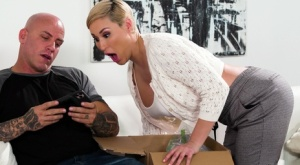 Busty blonde Ryan Keely gives her man friend a nude massage before they fuck