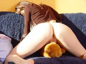 Busty amateur Vivian spanks her teddy bear during a nude modelling gig