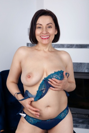 Middle-aged housewife Allegra cups her natural breasts after undressing