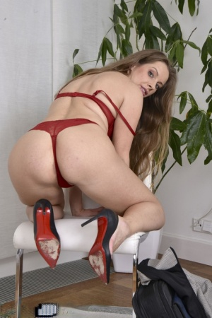 Over 30 businesswoman Kinuski strips down to a pair of heels on a chair