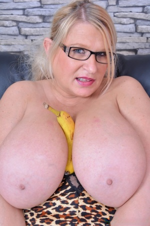 Overweight UK blonde Samantha Sanders sets her giant tits free of a brassiere