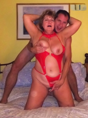 Older amateur Busty Bliss indulges in foreplay with her younger lover