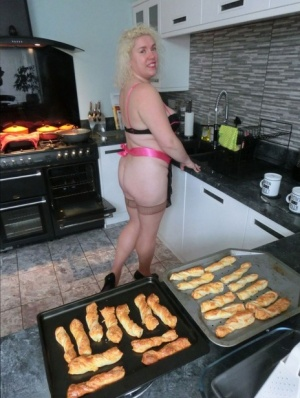 Aged blonde Barby removes lingerie to get naked in tan stockings while cooking