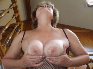 Older lady Busty Bliss removes her glasses before cupping her big natural tits