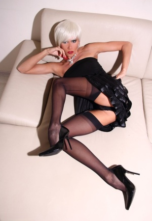 Platinum blonde amateur Eva Diangelo parts pussy lips in nylons and heels