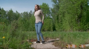 Solo girl Nastya pulls down tight jeans to pee on an old pad in a field