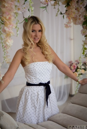 Young blonde Jessica Blank releases her great body from a pretty dress