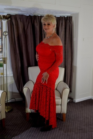 Older lady with short blonde hair Dimonty slips off a long red dress 58623719