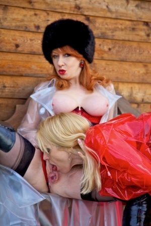 British lesbians expose boobs while modelling raincoats and thigh-high boots