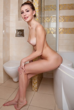 Young beauty with an ass to die for lets her hair down while taking a bath