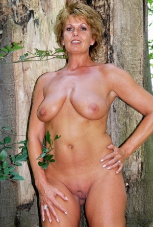 Older amateur Luscious Models displays her great body in front of an old tree 68302530