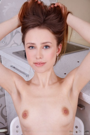 Fair skinned redhead Rosalind gets totally naked while grinding coffee beans