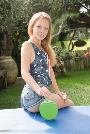 Young blonde Merelin gets butt naked atop an outdoor ping-pong table