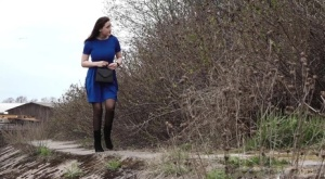Caucasian chick Alexa squats for a piss over a bank in suede boots
