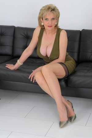 Older British blonde Lady Sonia exposes her tits and twat in nylons and heels