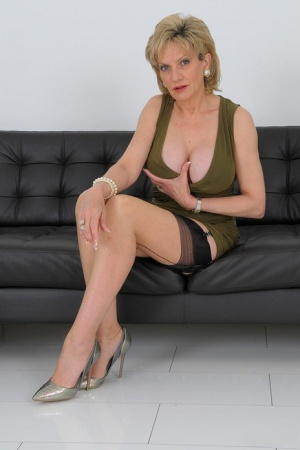 Older British blonde Lady Sonia exposes her tits and twat in nylons and heels 81709333