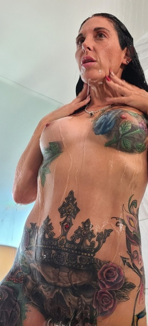 Tatted older woman Marie Bossette highlights her pierced pussy while showering