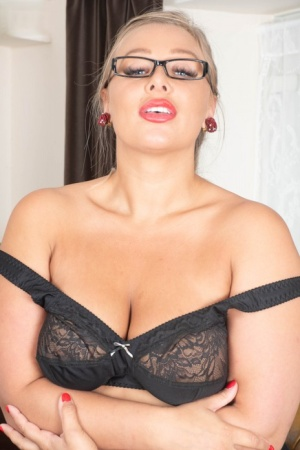 Thick blond secretary Beth Bennett bares her big tits before vaginal spreading