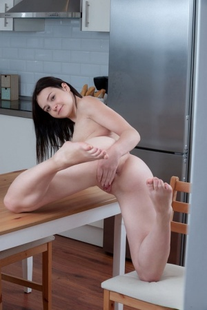 Young brunette Matty finger spreads her tight pussy in the kitchen