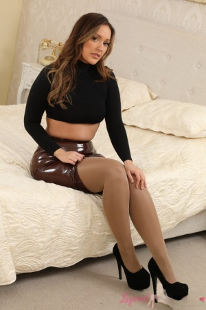 Solo girl Frankie L removes a latex skirt while going topless in hose  nylons
