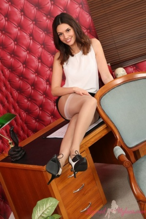 Beautiful girl Abigail B sports pantyhose over top of her nylons