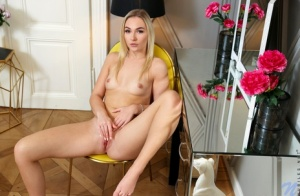 Blonde coed Jenny Wild strokes her beautiful pink pussy after getting naked