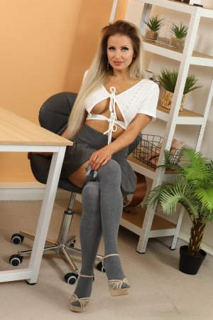 British secretary Chloe Welsh shows her firm tits in grey over the knee socks