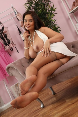 Brunette chick Kay releases her nice tits from a white dress in nylons