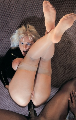 Big titted blonde Emilia seduces a well hung black porter in her hotel room