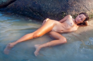 Teen model Regina C splashes in the ocean during a totally nude shoot